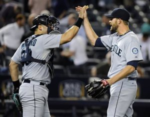 Tom Wilhelmson and Jesus Montero celebrate after the final out of last night's Mariners game
