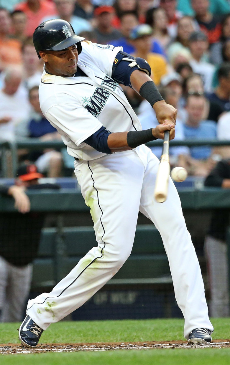 Mariners right fielder Nelson Cruz connects for a solo homer in first inning against the Baltimore Orioles, Tues., Aug., 11, 2015, at Safeco Field in Seattle.   (Ken Lambert / The Seattle Times)