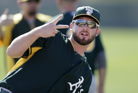 "Oakland Athletics pitcher Ryan Cook gestures while stretching during spring training baseball practice Saturday, Feb. 15, 2014, in Scottsdale, Ariz. Cook's training may be ""a couple weeks behind"" the rest of the pitchers because of inflammation in the right shoulder, according to Athletics manager Bob Melvin. (AP Photo/Gregory Bull)"