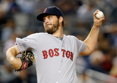 FILE - In this Sept. 30, 2015, file photo, Boston Red Sox starting pitcher Wade Miley delivers in the first inning of a baseball game against the New York Yankees, in New York. The Seattle Mariners have obtained left-hander Wade Miley and reliever Jonathan Aro from the Boston Red Sox for reliever Carson Smith and pitcher Roenis Elias, Monday, Dec. 7, 2015. (AP Photo/Kathy Willens, File)