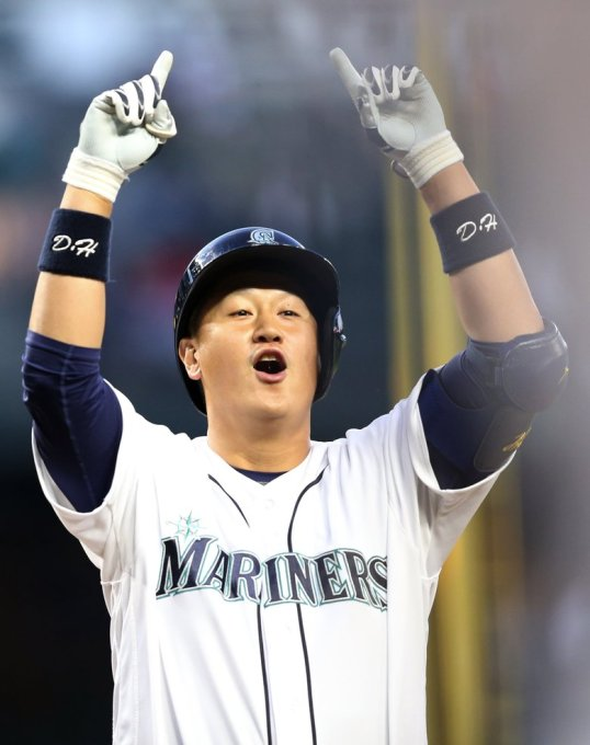 Mariners first baseman Dae-Ho Lee points skyward as he steps on home plate after his three run homer in the fourth inning against Tampa Bay, Tuesday, May 10, 2016, at Safeco Field in Seattle.