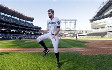 Seattle Mariners' Tom Wilhelmsen dances on the field after a baseball game against the Los Angeles Angels Sunday, Sept. 28, 2014, in Seattle. The Mariners won 4-1. (AP Photo/Elaine Thompson)